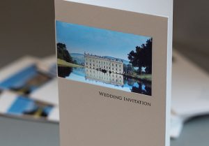 beautiful wedding invitations with a photo of your venue